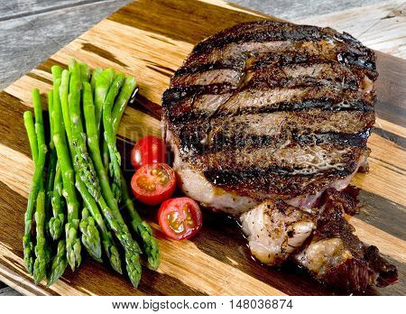 Fresh grilled thick rib eye steak ready to eat.