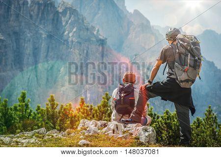 Hiker and Biker on a Trail Enjoying Amazing Mountain Vista.