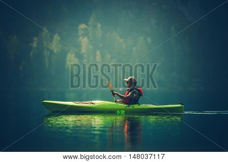 Kayak Tour on the Lake. Middle Age Caucasian Men in the Kayak on the Scenic Lake.