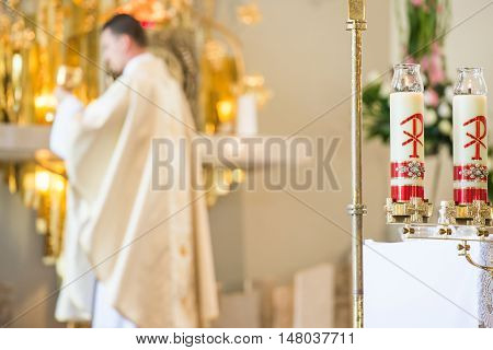 Catholic Priest Praying During Eucharist. Roman Catholic Church