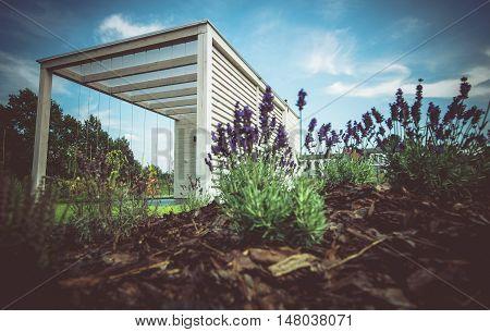 White Modern Gazebo in the Newly Designed Garden. Wooden Arbor.