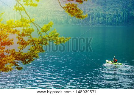 Scenic Kayak Tour on the Lake in a Summer Day. Kayaking Theme.