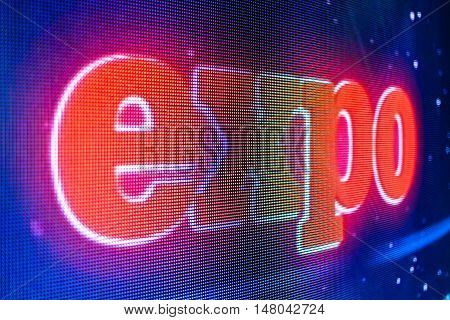 Bright colored expo sign at the LED smd screen - close up background