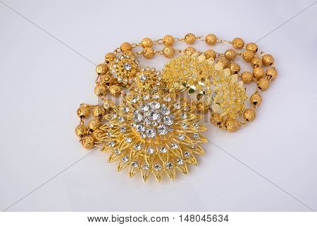 Shiny Gold  Jewelery On White Background