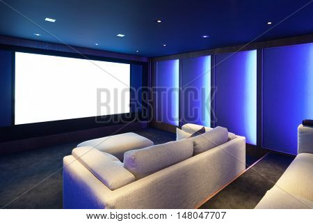 Home theater, luxury interior, comfortable divan and big screen