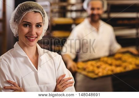 Portrait of female baker smiling in bakery shop