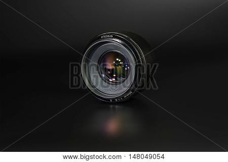 lens 50mm / 1.8 black on a dark background