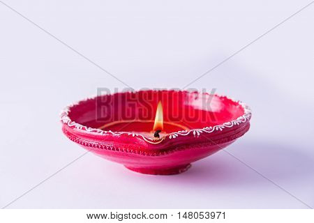 Clay diya lamp lit during diwali celebration. Greetings Card Design Indian Hindu Light Festival called Diwali