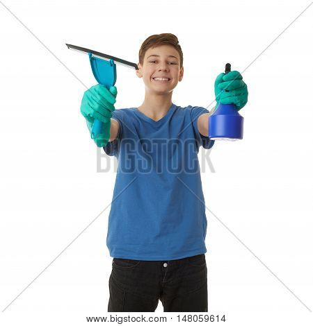 Cute teenager boy in blue T-shirt and green rubber gloves with window cleaning squeegee tool over white isolated background, half body, cleaning concept