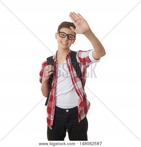 Cute teenager boy in red checkered shirt and glasses with school bag, waving hand over white isolated background, half body, as school, education concept