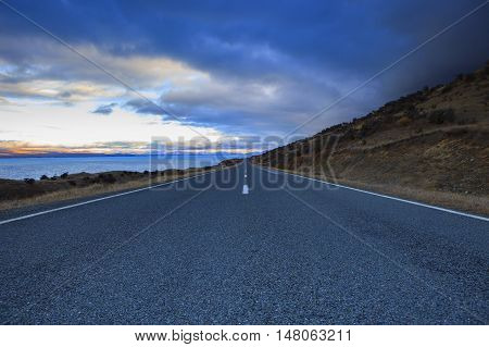 asphalt highway in aoraki - mt.cook national park new zealand