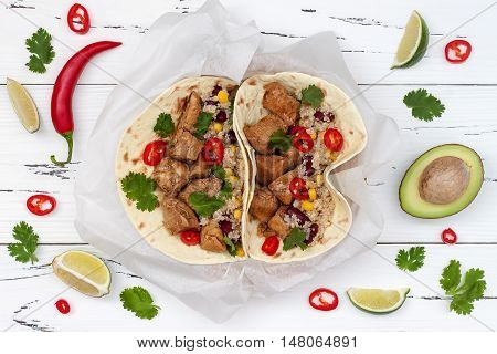 Mexican tacos with quinoa salad meat black beans and corn on rustic wooden table. Recipe for Cinco de Mayo party. Top view.