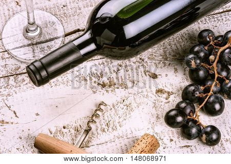 Setting with bottle of red wine grape and corks. Wine list concept