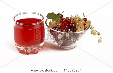 The berry juice in a glass. Berries in a glass bowl. The juice of the red and white currants. Cherry juice.