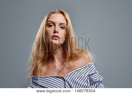 Sensual woman in unbuttoned shirt with temptation expression