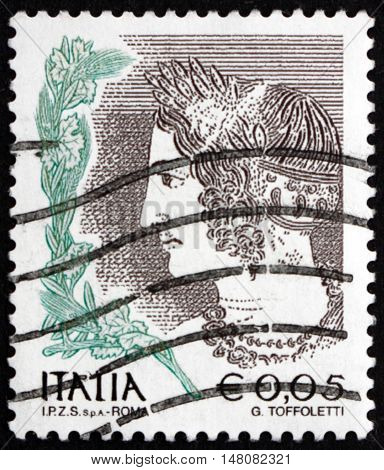 ITALY - CIRCA 2002: a stamp printed in the Italy shows Young Velca Etruscan Tomb circa 2002