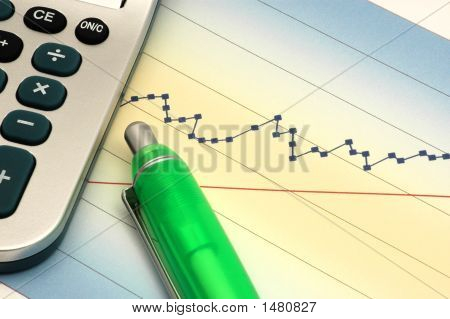 Close-Up Of Stock Report With Calculator And Green Pen