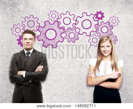 Two attractive caucasian businesspeople on concrete background with creative gears sketch. Team work concept