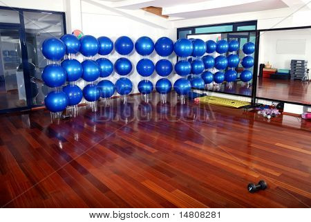 fitness club indoor with blue pilates balls in background poster