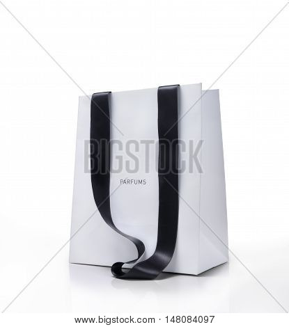 White shopping bag with black handles. Parfums concept.Clipping path just on bag.