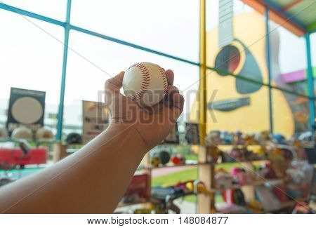 Man Holding Baseball in a secondhand shop