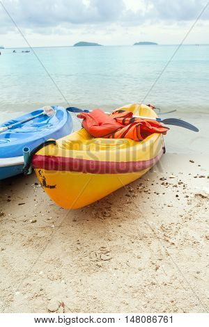 Plastic Boat on the beach with sea background .