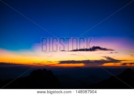 Mountain Silhoette Of Sub Alpine At Sunrise Glowing Sky