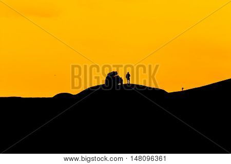 human silhouette of the car and making off-road in the mountainous area.