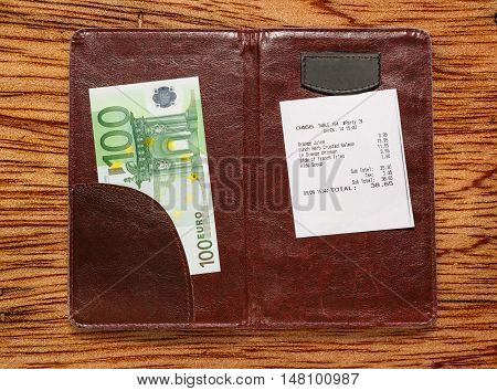 Open Check Folder With Bill And Euro