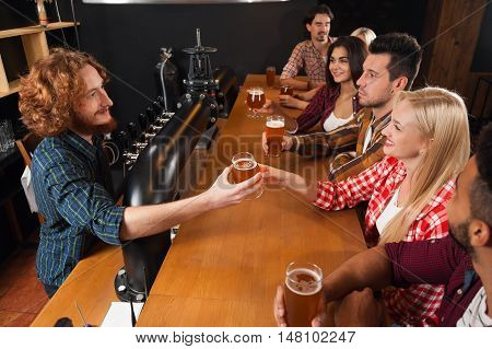 Young People Group In Bar, Barman Give Beer, Friends Sitting At Wooden Counter Pub Top View, Friends Communication Party Celebration