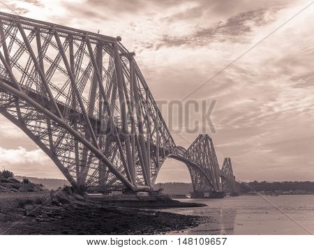 Forth Rail Bridge at dusk in Edinburgh, Scotland, connecting the towns of North and South Queensferry