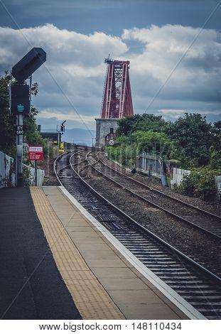 North Queensferry train station with railtrack leading to the Forth Rail Bridge in Edinburgh, Scotland