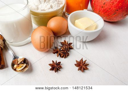 Selection of ingredients for making a traditional pumpkin pie for Thanksgiving or Halloween, copy space