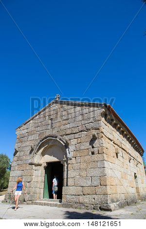 GUIMARAES, PORTUGAL - SEPTEMBER 18, 2016: people at tghe Sao Miguel Chapel and the Guimaraes Castle, where medieval knights are buried. Guimaraes, Portugal. UNESCO World Heritage Site