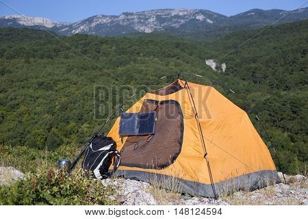 the solar panel on a tent in mountains