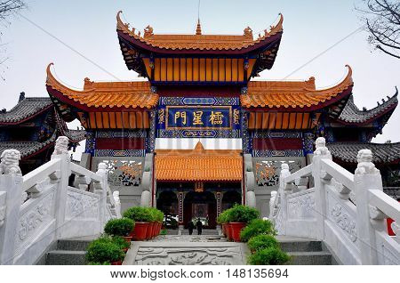 Langzhong Ancient City China - October 22 2013: The Pan Pond Bridge and Star Lattice Gate at the Confucious Temple *