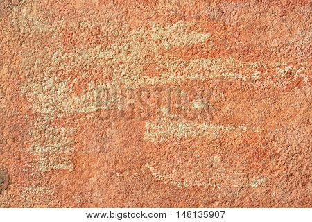 Abstract old terracotta plastered red wall texture background.