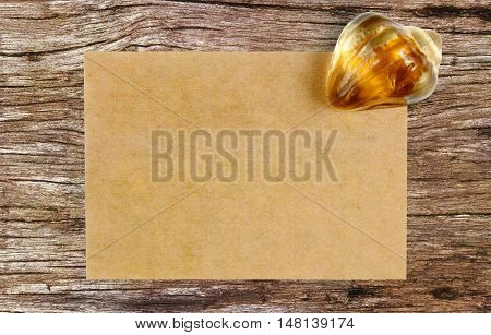 blank recycle paper with paperweight on ancient wooden table background