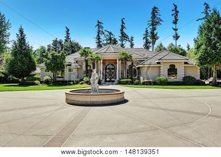 Suburban Family House With Fountain Statue In The Front Yard