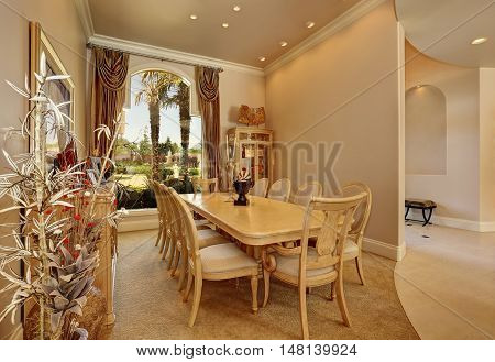 Luxury Beige Dining Room Interior With Large Window