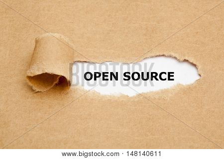The text Open Source appearing behind torn brown paper.