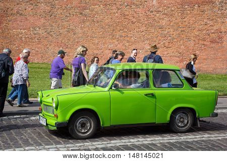 POLAND, KRAKOW - MAY 27, 2016: The legendary car brand Trabant on the streets of Krakow. The Trabant is an automobile that was produced from 1957 to 1990 by former East German (GDR).