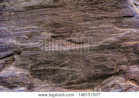 Brown weathered rock background. Stone surface background. Old rock texture. Stone texture.
