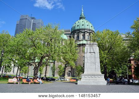 MONTREAL QUEBEC CANADA 09 16 2016: Dome of the Cathedral-Basilica of Mary, Queen of the World, is the seat of the Roman Catholic archdiocese of Montreal and Place ville Marie Buildings in background.