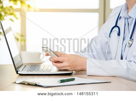 Doctor Using Smart Phone Research Internet, Healthcare And Medicine Concept