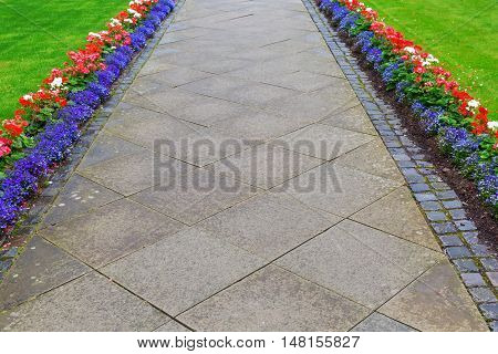 footpath from conrete paver zoned by a flower border