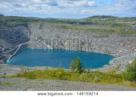 Aerial view of Asbestos mine, Asbestos, Quebec, Canada. Asbestos is a set of six naturally occurring silicate minerals used commercially for their desirable physical properties.