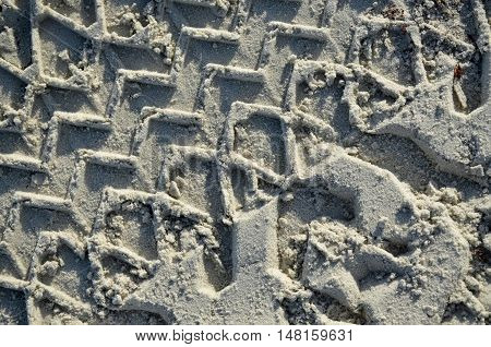 Tire track pattern on a sandy beach