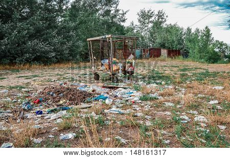 Nature and a big amount of garbage on grass