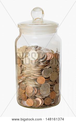 A large collection of loose change in a big glass jar with a lid isolated on a white background with a clipping path
